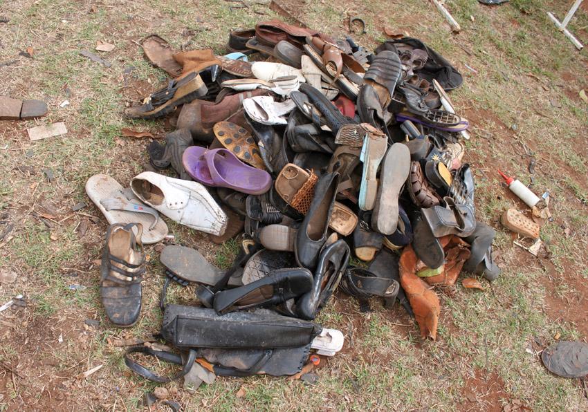 A Pile Of Old Shoes Outside The Shoe Shop Motogeo